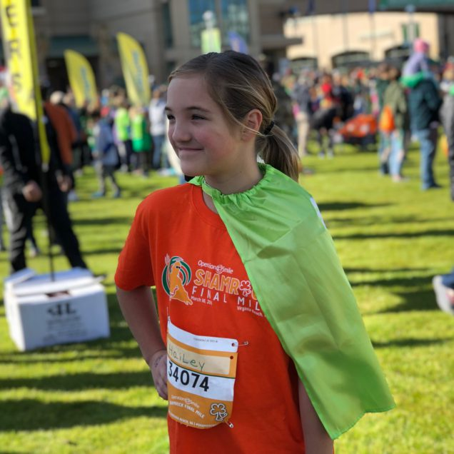 Final Mile VIP runner Hailey Dore assumed a super-hero stance just before the Final Mile on March 16, 2019.